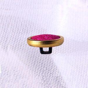 gold rim covered button