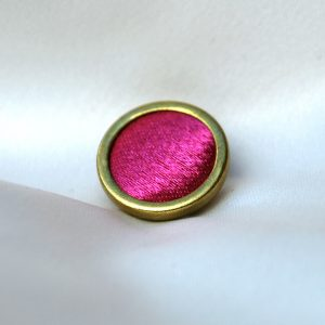 Rimmed covered button
